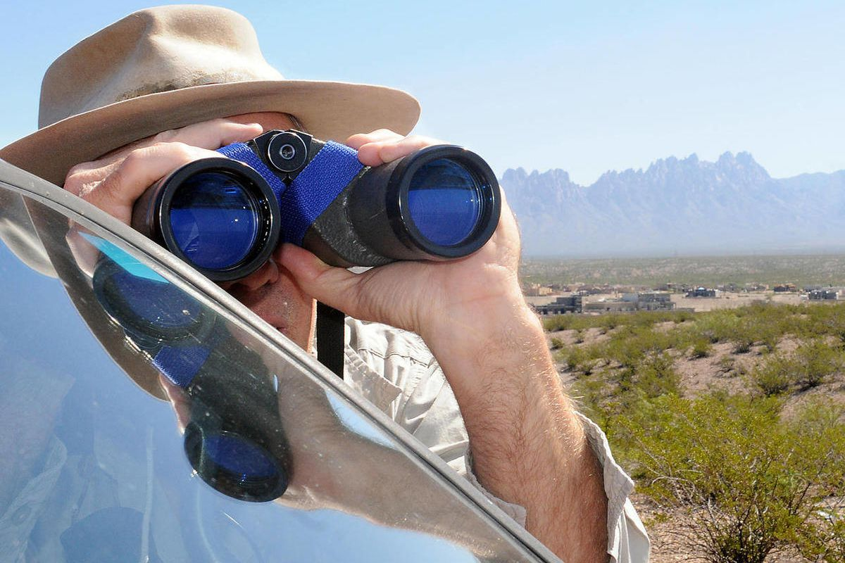 """Bill Mader, of Las Cruces, checks out the Endeavour flyover with his binoculars on Thursday, Sept. 20, 2012.. """"God, it's really something,"""" he said while he mentioned that his brother, Dr. Thomas Mader, of Anchorage, Alaska, was an optical surgeon who had"""