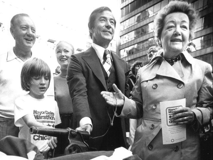 Eleanor Daley (right) on the reviewing stand at the Daley Center Plaza with Mayor Michael Bilandic (from left), his wife, Heather, and marathon organizer Lee Flaherty at the first Mayor Daley Marathon in 1977. Flaherty founded the marathon and asked his l