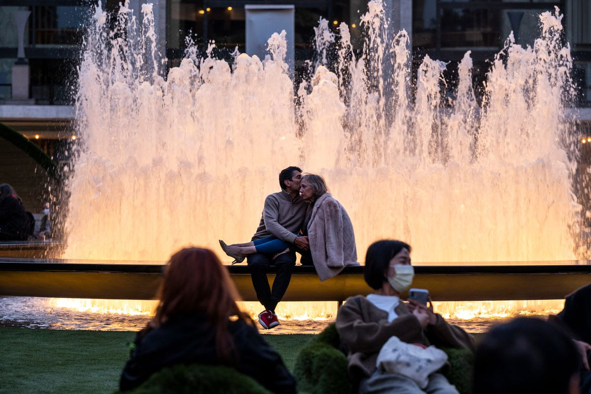 A couple share a kiss at the Lincoln Center's Revson Fountain, May 14, 2021.