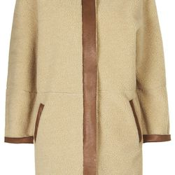 """<strong>Stage Four:</strong> Topshop's faux shearling coat may not be as soft as the real deal, but it packs the same style punch.<br></br>  Topshop faux shearling 'Ovoid' jacket, <a href=""""http://us.topshop.com/en/tsus/product/clothing-70483/jackets-coa"""
