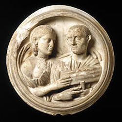 """""""Roundel with busts of a man and a woman,"""" 250-270 A.D. (marble, 18 1/8 by 18 7/8 inches)."""