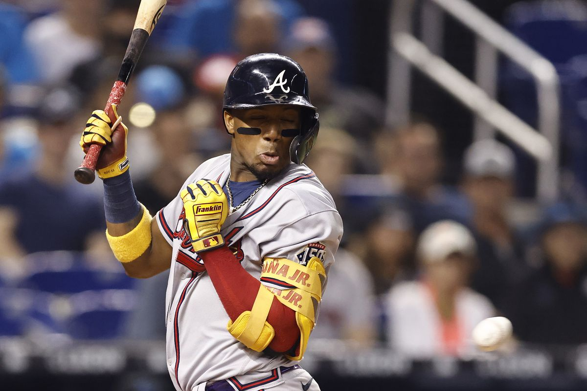 Ronald Acuna Jr. #13 of the Atlanta Braves is hit by a pitch against the Miami Marlins during the seventh inning at loanDepot park