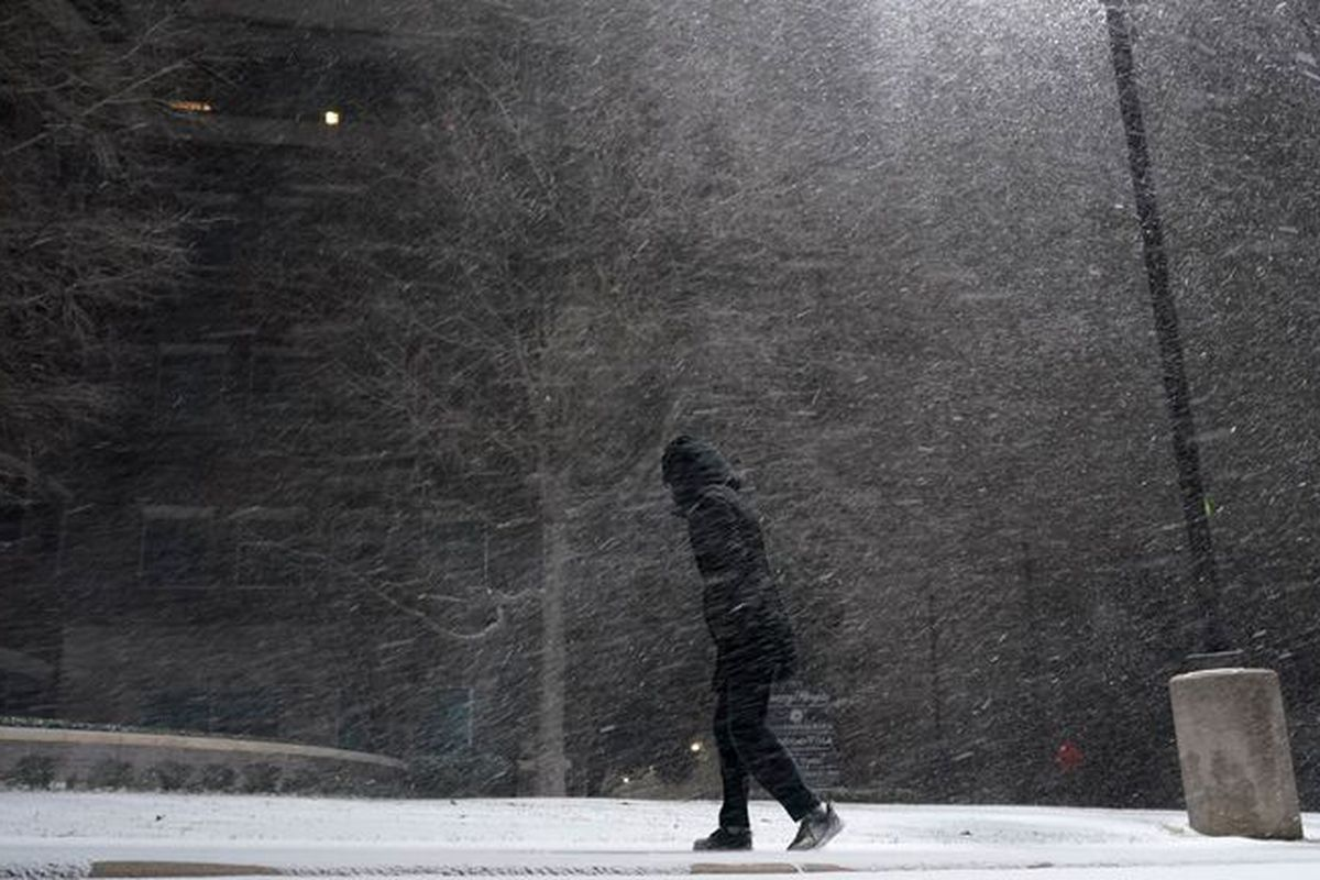 Person walking in snow storm