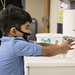 A preschool student washes his hands after breakfast Monday morning at Dawes Elementary School at 3810 W. 81st Pl. on the Southwest Side.
