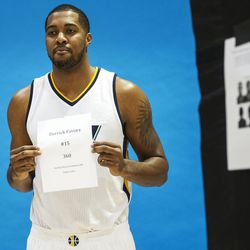 Utah Jazz forward Derrick Favors holds up a name card before being photographed for his video game character during Media Day at Zions Bank Basketball Center in Salt Lake City on Monday, Sept. 26, 2016.