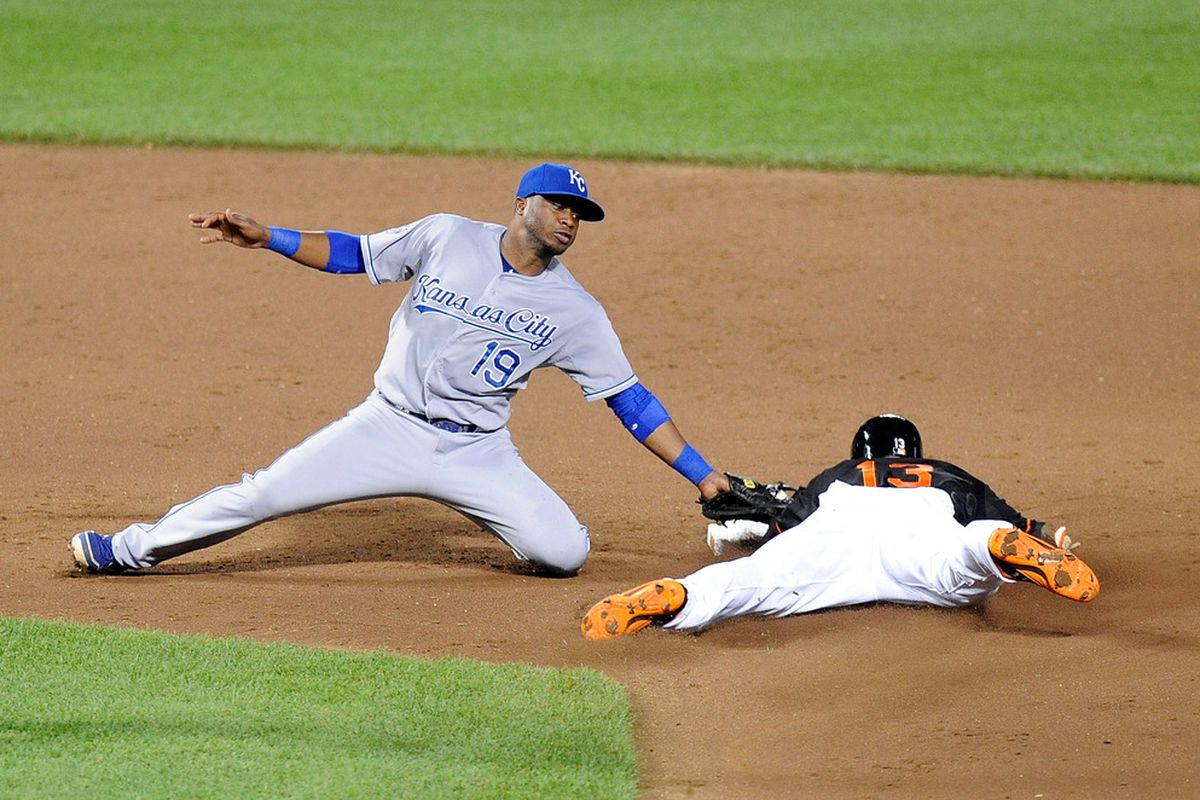 BALTIMORE, MD - MAY 25:  Xavier Avery #13 of the Baltimore Orioles steals second base ahead of the tag by Irving Falu #19 of the Kansas City Royals at Oriole Park at Camden Yards.