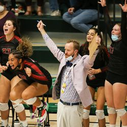 Mountain View players and coaches cheer after the team scored a point in a UHSAA 5A volleyball state championship game at Hillcrest High School in Midvale on Saturday, Nov. 7, 2020.