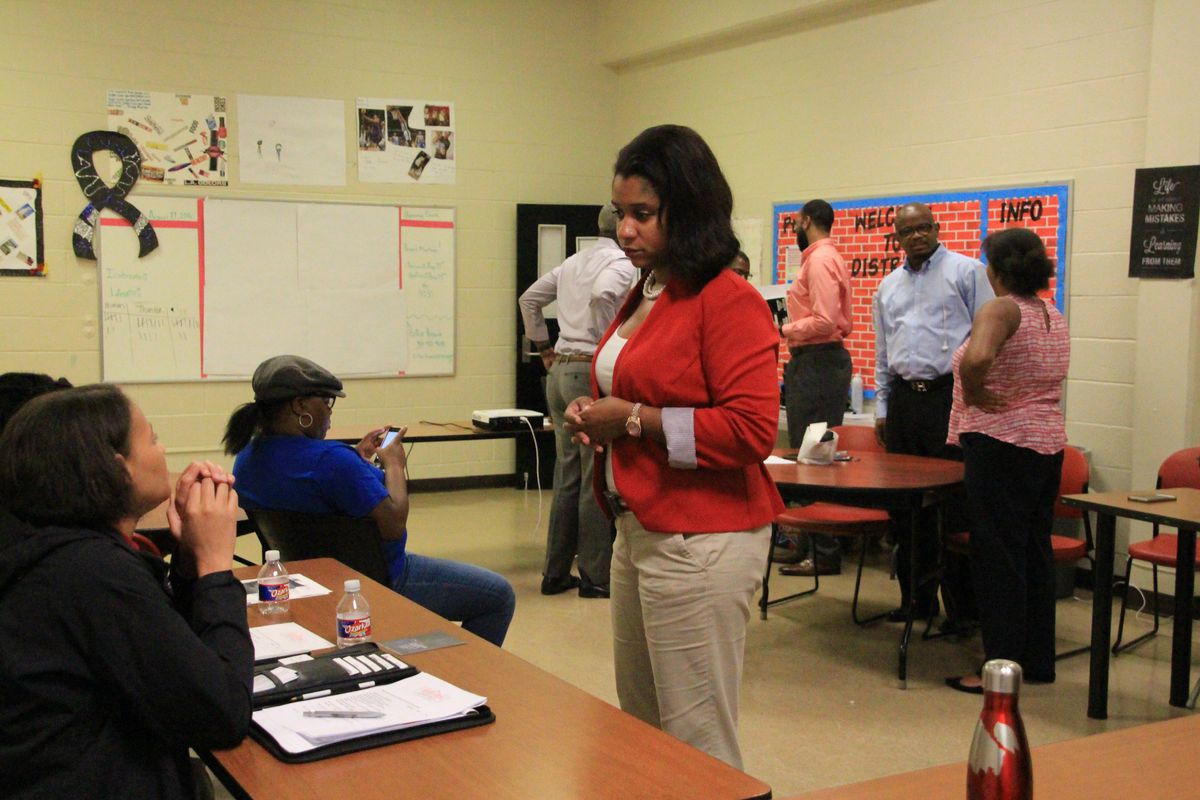 Leshundra Robinson, a Memphis organizer for The Campaign for School Equity, speaks with a parent in Memphis' Whitehaven community.