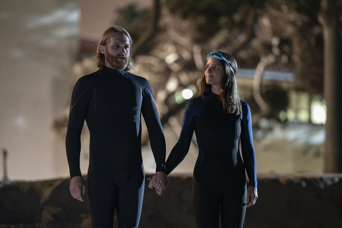 Wyatt Russell's character in a wetsuit