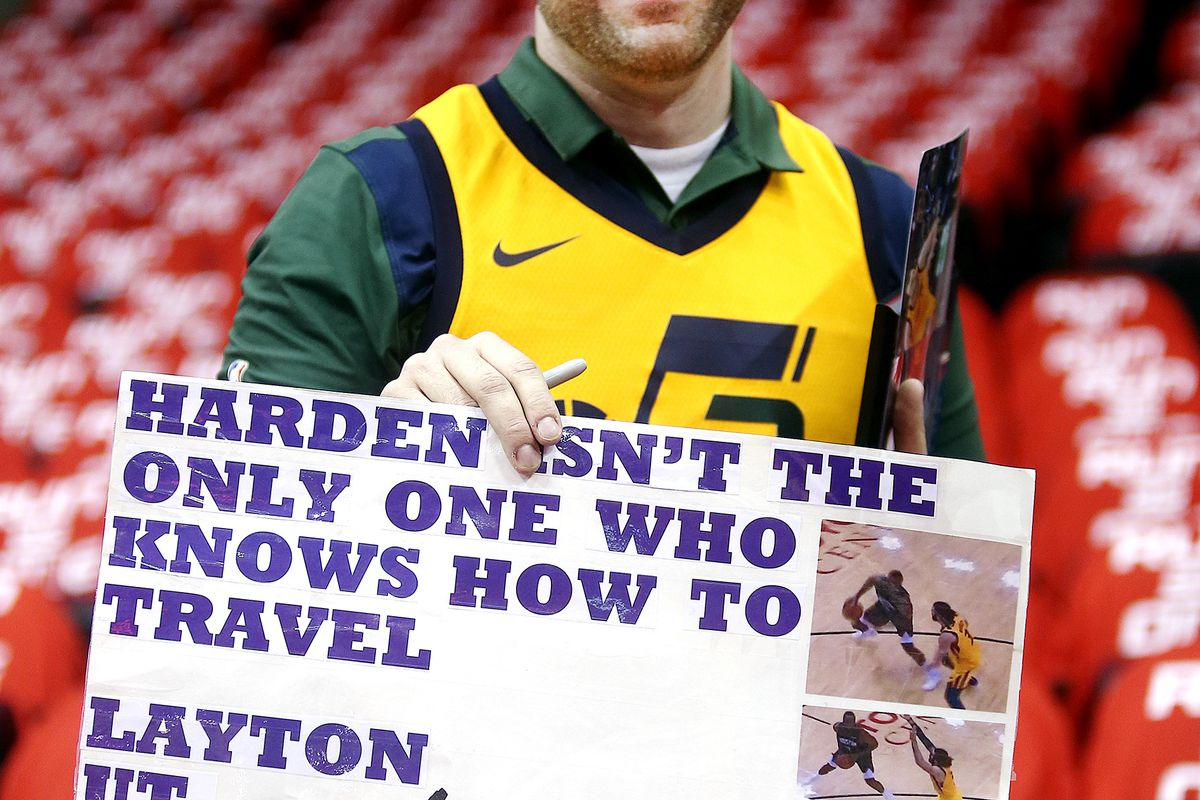 Chad Crowell of Layton Utah poses with a sign he made for the game as the Utah Jazz and the Houston Rockets play in game 2 of the NBA Western Conference playoffs at the Toyota Center in Houston Texas on Wednesday, April 17, 2019.