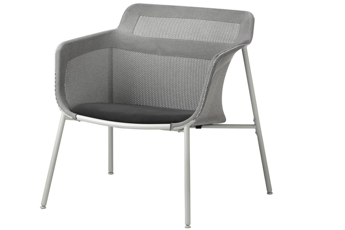 A simple armchair with white frame and a snugly fitting mesh material forming the seat, sides, and backrest.
