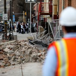Fallen debris is seen at a building at 500 South and 400 West in Salt Lake City after a 5.7 magnitude earthquake centered in Magna hit on Wednesday, March 18, 2020.