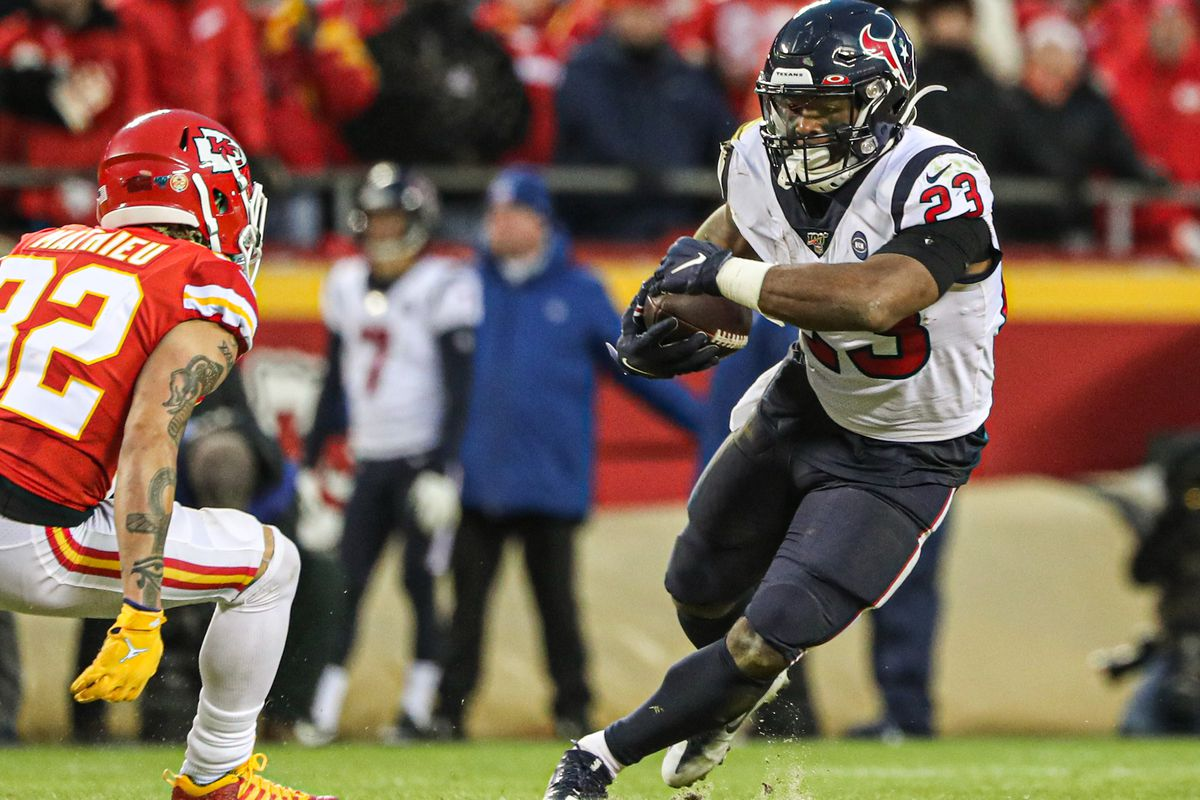 Houston Texans running back Carlos Hyde runs against Kansas City Chiefs strong safety Tyrann Mathieu during the second half in a AFC Divisional Round playoff football game at Arrowhead Stadium.