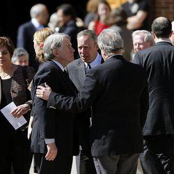 Friends console John Huebner, Deedee Corradini's husband,   following the memorial service for Deedee Corradini at Wasatch Presbyterian Church in Salt Lake City, Monday, March 9, 2015.