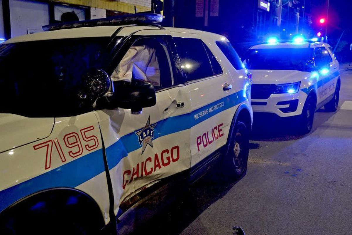 Driver runs red light, hits police vehicle in Brighton Park