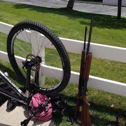 Police say they arrested Kevin Henrie, 58, after he crashed into a power pole on a bicycle while carrying two guns on Monday, Aug. 4, 2014. Henrie is a restricted person and is not allowed to possess a firearm.