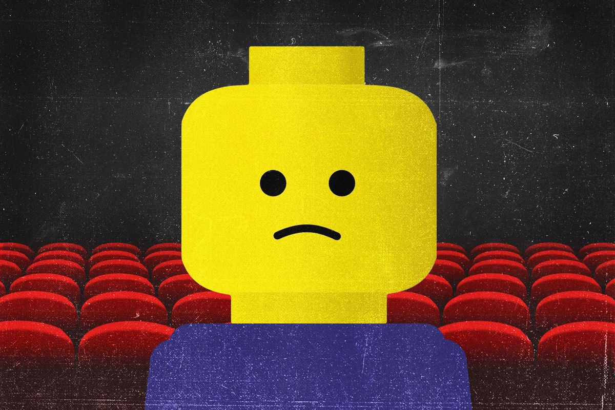 A Lego person frowning in an empty movie theater