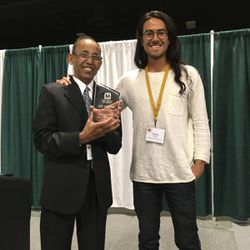 Safi Safiullah, the Salt Lake City Library's Marmalade Branch manager and Utah Library Association Librarian of the Year, left, stands with Tommy Hamby, adult services coordinator for the Salt Lake City Public Library.