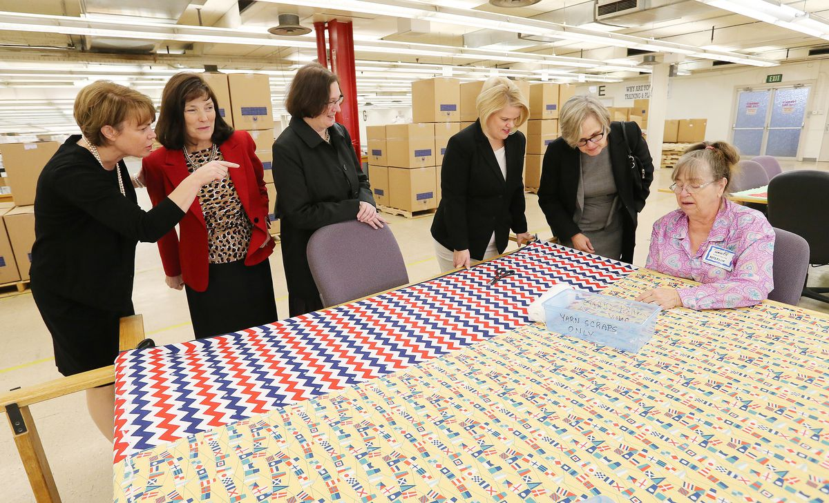 Sharon Eubank, president of Latter-day Saint Charities points out the quilting work of Nancy Petersen to members of Lutheran Immigration and Refugee Service as they tour the LDS Humanitarian Center and Deseret Manufacturing in Salt Lake City on Tuesday, Oct. 18, 2016.