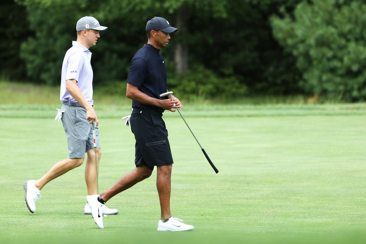 Justin Thomas, left, and Tiger Woods of the United States walk together during a practice round for the The Northern Trust golf tournament at TPC Boston on August 19, 2020 in Norton, Massachusetts.
