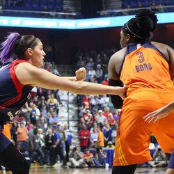 Connecticut Sun's Kelsey Bone (3) is defended by Washington Mystics' Stefanie Dolson (31).