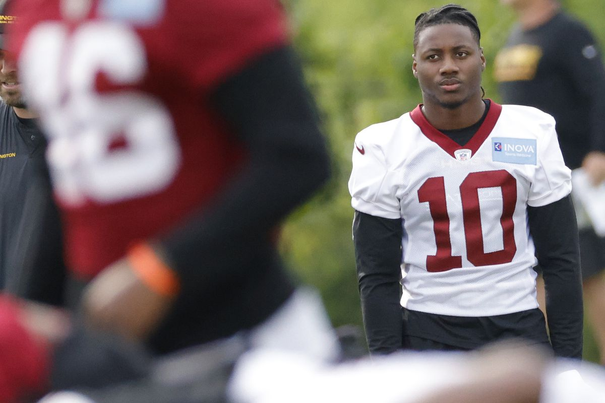 Washington Football Team wide receiver Curtis Samuel (10) looks on during drills as part of an OTA at Inova Sports Performance Center.