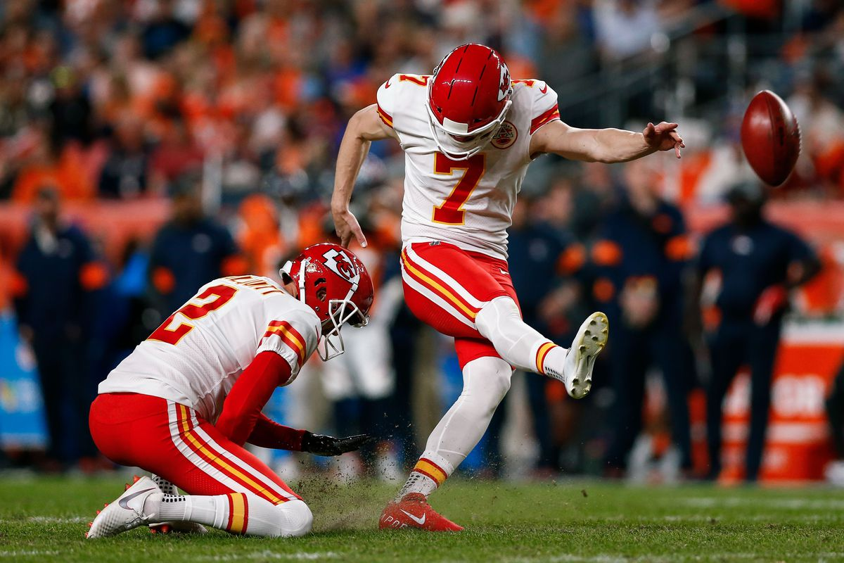 Kansas City Chiefs kicker Harrison Butker kicks a field goal as punter Dustin Colquitt holds the ball in the second quarter against the Denver Broncos at Empower Field at Mile High.