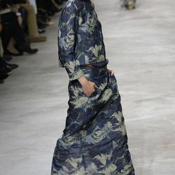 A model wears a creation by Belgian fashion designer Dries van Noten for fashion house's Spring Summer 2013 ready to wear collection, for Fashion Week, in Paris, Wednesday, Sept. 26, 2012.