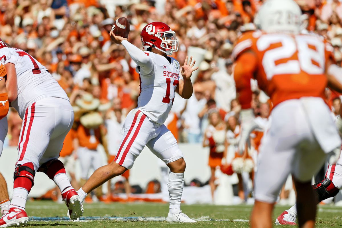 Oklahoma Sooners quarterback Caleb Williams passes the ball against the Texas Longhorns during the second quarter at the Cotton Bowl.