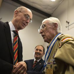 President Henry B. Eyring, first counselor in the First Presidency of the Church of Jesus Christ of Latter-day Saints, greets Elder Glen Rudd, emeritus Seventy, as Utah Gov. Gary Herbert looks on before dedicating the Thomas S. Monson Lodge at the Hinckley Scout Ranch in the Uinta Mountains on Wednesday, Oct. 5, 2016.