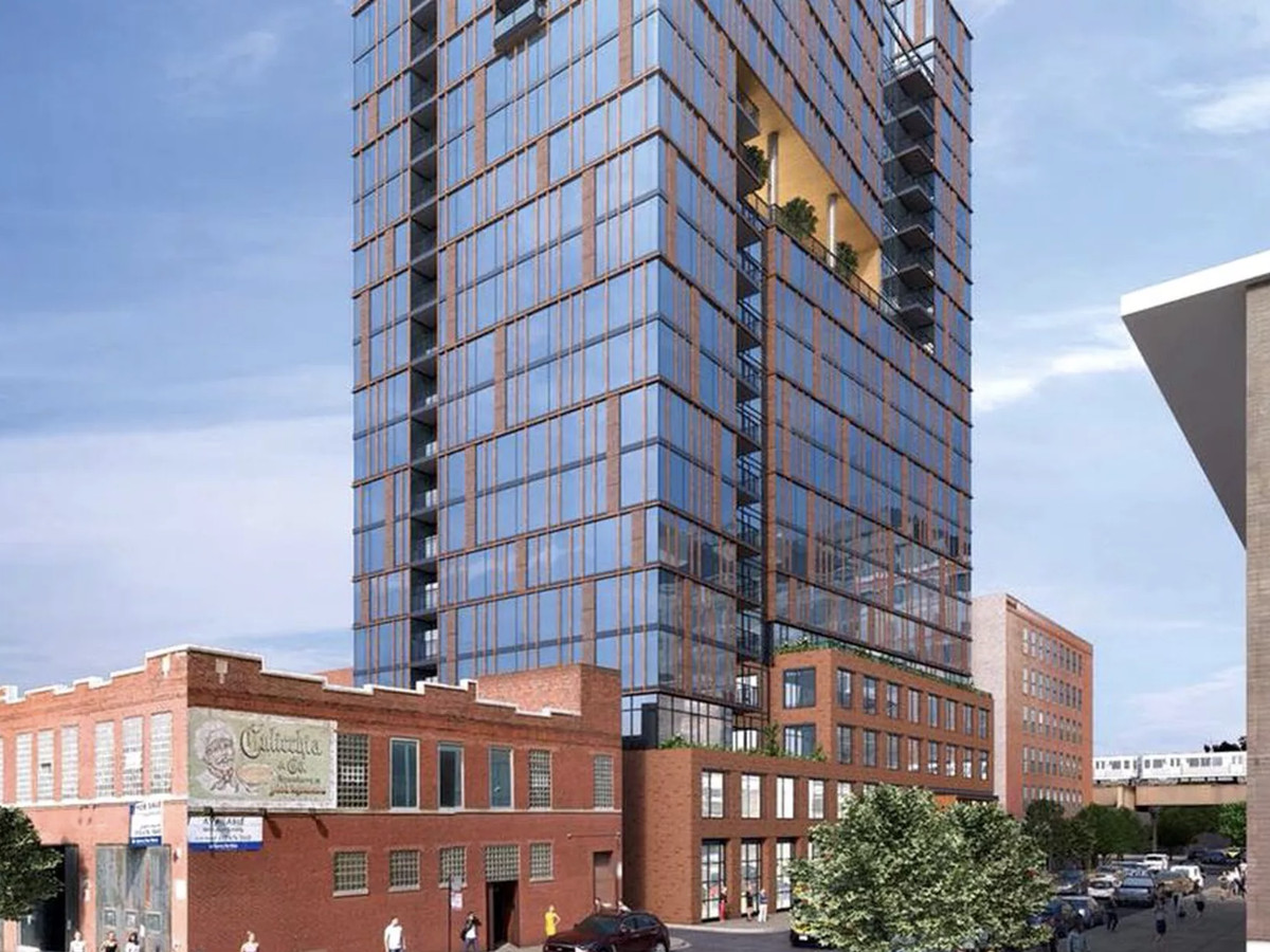 A four-story red brick base supports a glassy apartment tower rising 20 stories. The upper levels have inset balconies that follow a zig-zag pattern up the building's side.