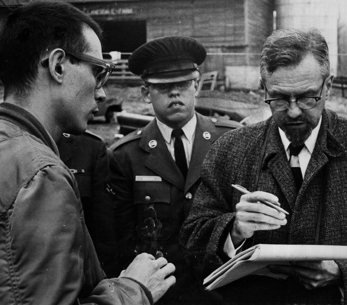 J. Allen Hynek in 1966, taking notes on a reported UFO sighting in Michigan. Before coming to Northwestern University, where he chaired the astronomy department, his past posts included having been associate director of the Smithsonian Astrophysical Observatory at Harvard University.
