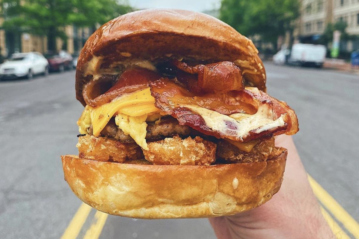 The Animal from Cracked Eggery comes with bacon, sausage, salted tots, American and cheddar cheeses, and a special sauce.