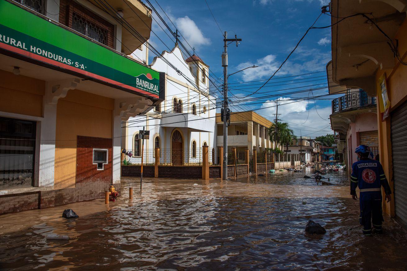 An El Salvadorian rescue team member navigates through the...