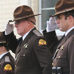 UHP troopers salute as the casket of former Utah Gov. Olene Walker is carried from the LDS Canyon Rim Stake Center in Millcreek after her funeral on Friday, Dec. 4, 2015. Walker died of natural causes at age 85.