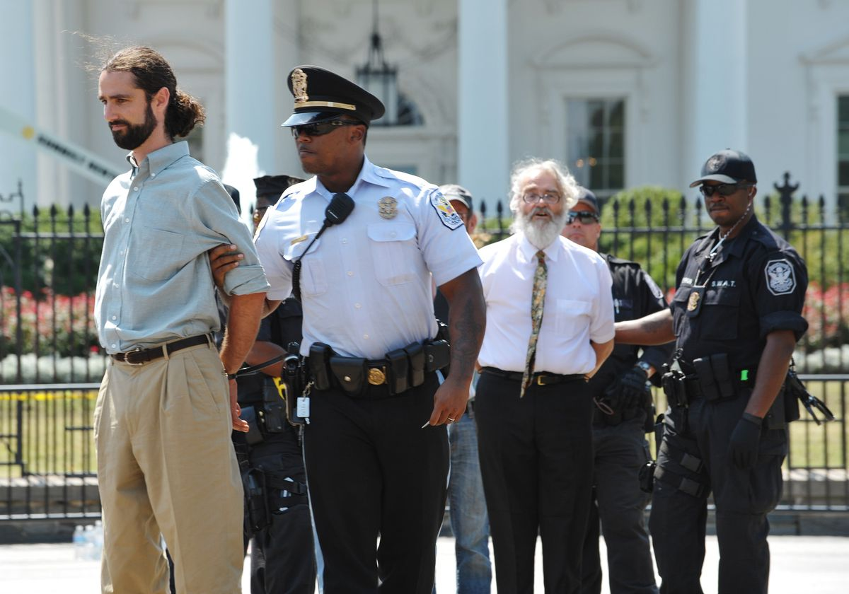 Police arrest protesters demonstrating infront of the White House on August 24, 2011 in Washington, DC. Over 50 demonstrators protesting against the construction of the Keystone XL oil pipeline from Alberta's oilsands to Texas, were arrested.