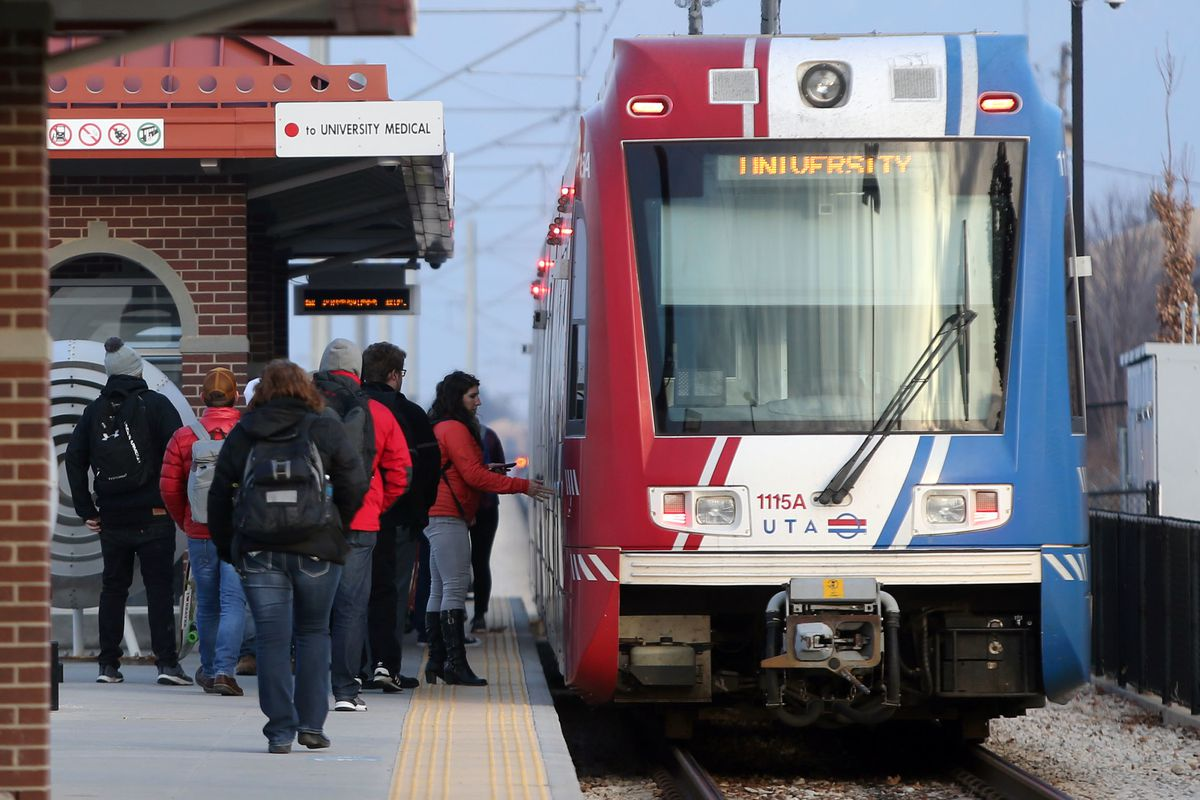 People board a red line train at the Bingham Junction TRAX Station in Midvale on Friday, Jan. 5, 2018.