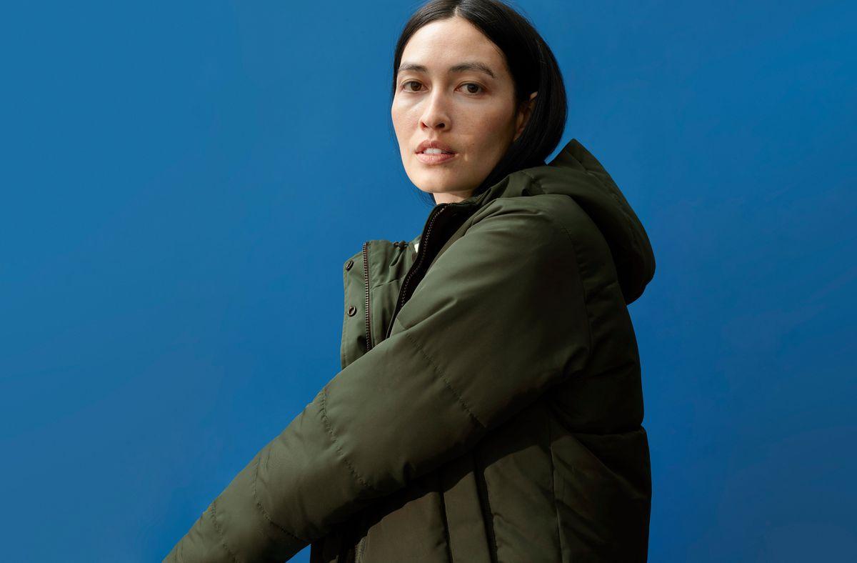 A model wears a green parka.