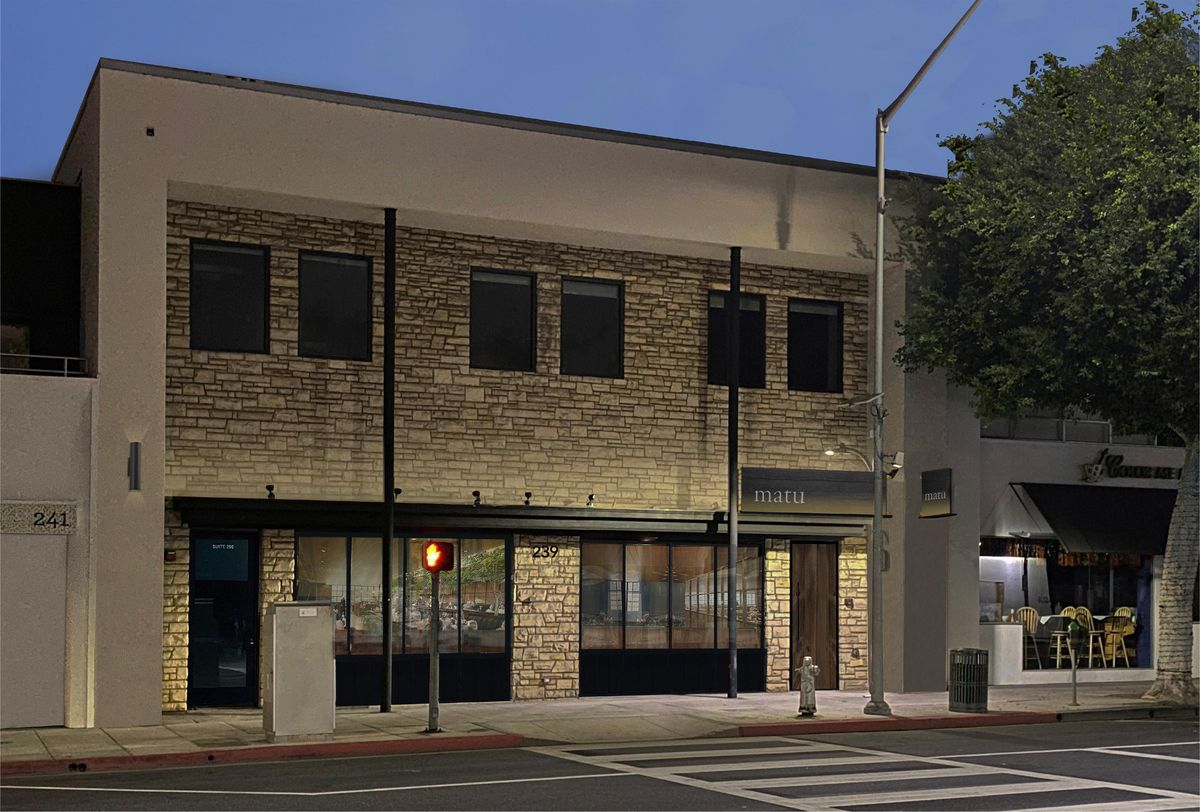 A rendering for the exterior of a restaurant with limited signage and lots of stone work.