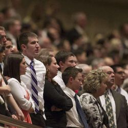 Audience members stand song sing during the morning session of 183 annual General Conference of the Church of Jesus Christ of Latter Day Saints Saturday, April 6, 2013 inside the Conference Center.