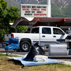"""A group collects donations for the Ogden Rescue Mission and the Lantern House outside Kirt's Family Drive Inn in Ogden on Monday, May 25, 2020. """"I've been surprised, many people said 'thanks for giving us the opportunity to help, we just didn't know how,'"""" Grant Protzman said. """"There's a real need."""""""