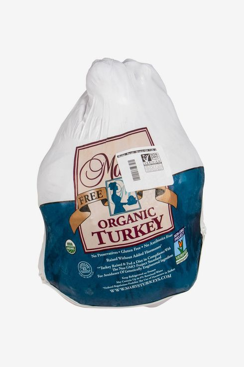 Uncooked turkey in plastic packaging.