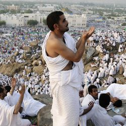 Muslim pilgrims pray on a rocky hill called the Mountain of Mercy on the Plain of Arafat near the holy city of Mecca, Saudi Arabia, Thursday, Oct. 25, 2012. Saudi authorities say around 3.4 million pilgrims — some 1.7 million of them from abroad — have arrived in the holy cities of Mecca and Medina for this year's pilgrimage. (AP Photo/Hassan Ammar)
