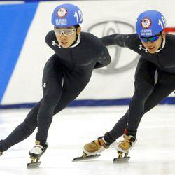 Thomas Insuk Hong, left, and Aaron Tran competes in the men's 1000-meter during the U.S.Olympic short track speedskating trials Sunday, Dec. 17, 2017, in Kearns, Utah. (AP Photo/Rick Bowmer)