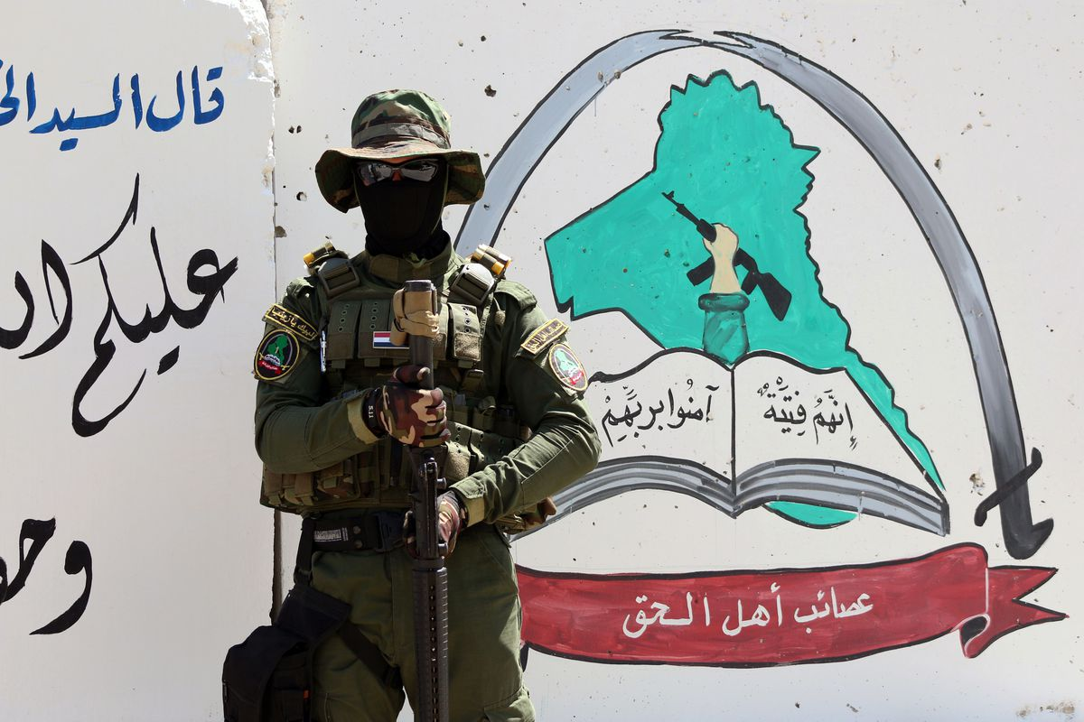 A member of an Iraqi Shia militia, many of which are tied to Iran, in the Iraqi city of Basra (HAIDAR MOHAMMED ALI/AFP/Getty)