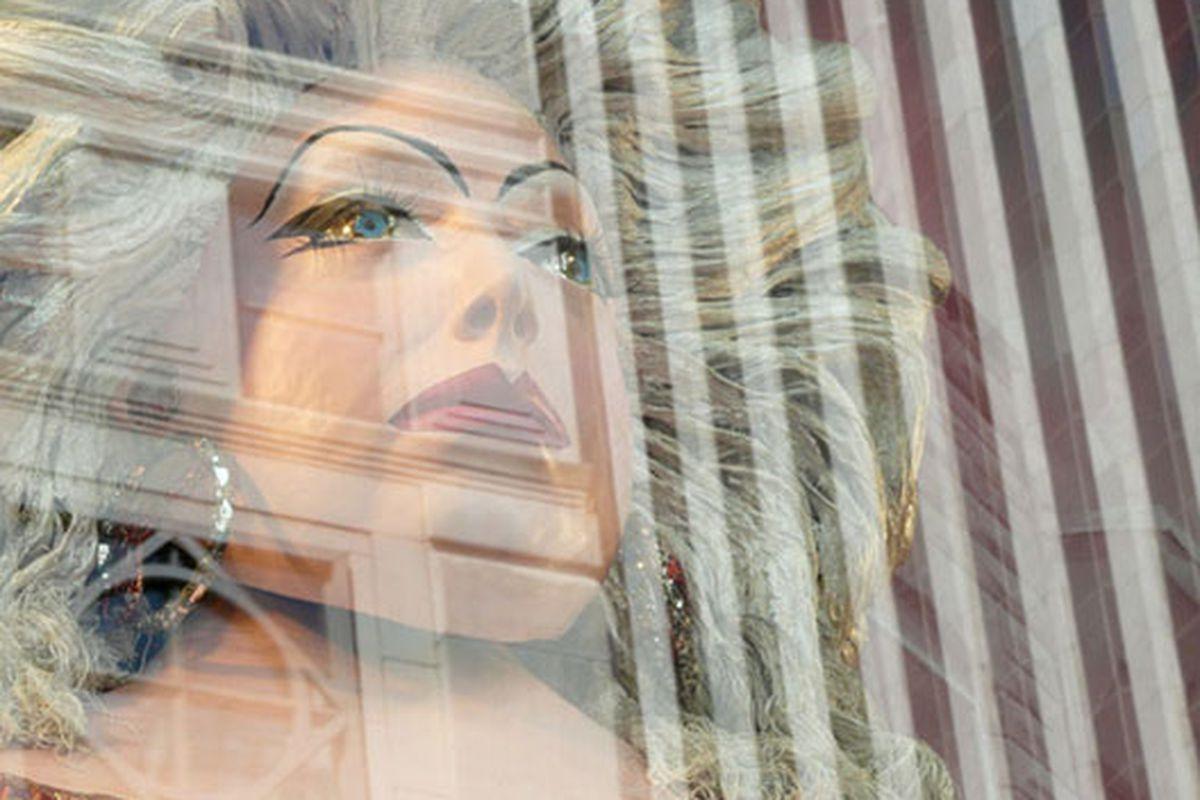 "Divine watches over Fifth Avenue.  Image via <a href=""http://modelizing.blogspot.com/2009/06/bergdorfs-x-american-visionary-art.html"">Modelizing</a>"