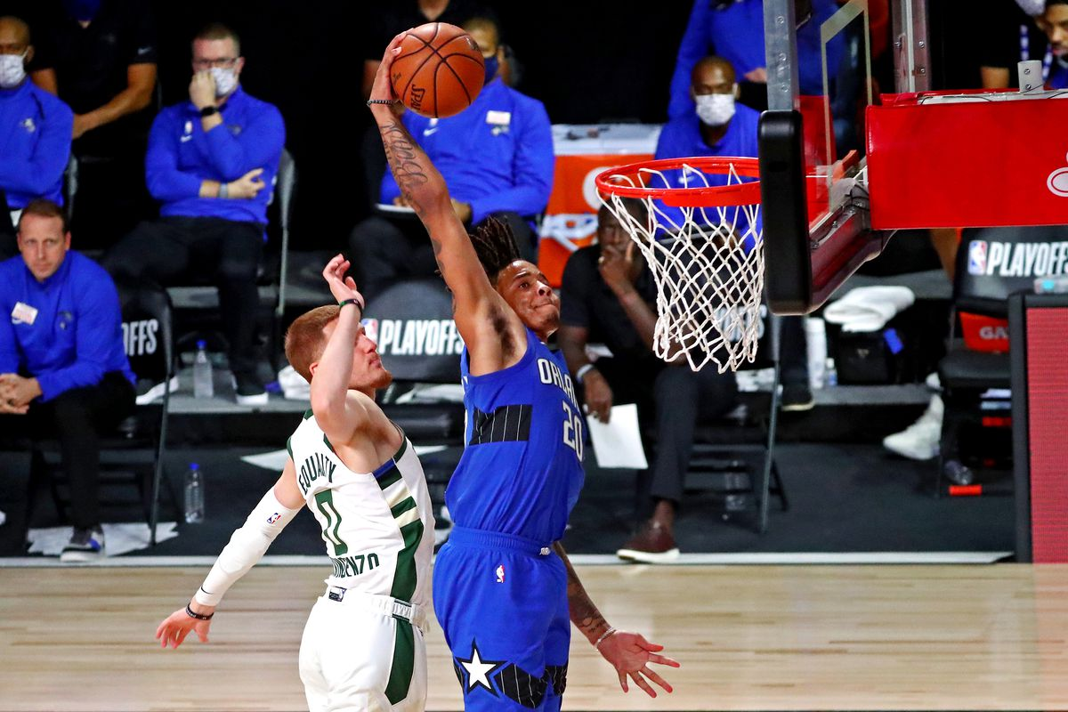 Orlando Magic forward Al-Farouq Aminu (2) dunks the ball against Milwaukee Bucks guard Donte DiVincenzo (0) during the fourth quarter in game five of the first round of the 2020 NBA Playoffs at AdventHealth Arena.