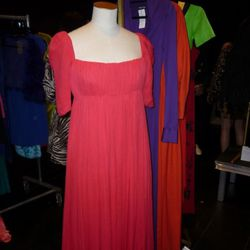 """The Alexander McQueen gown up for auction. The purple """"no hips"""" Halston gown is peeking out from the rack."""