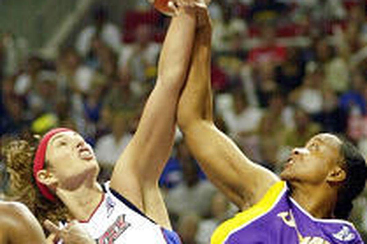 Los Angeles center Jennifer Gillom (22) fouls Detroit Shock center Ruth Riley during Sunday's WNBA Finals game.