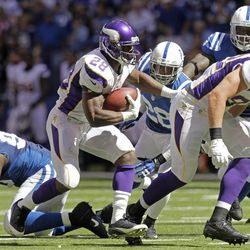 Minnesota Vikings' Adrian Peterson (28) runs during the first half of an NFL football game against the Indianapolis Colts in Indianapolis, Sunday, Sept. 16, 2012.